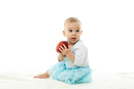 Sweet small baby with a fresh red apple on a white background  Stock Photo - 17412052