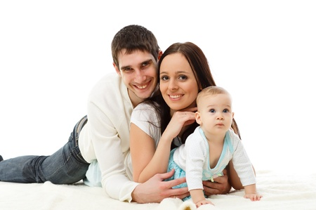 Young parents with their  sweet  baby on a white background  Happy family  Stock Photo - 17412047