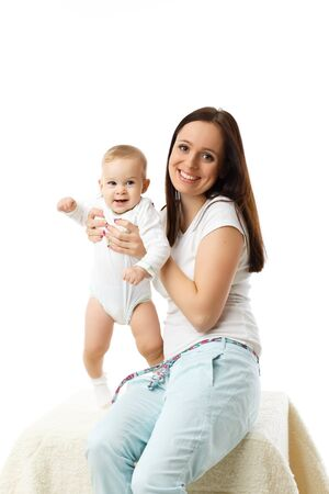 Mother with small baby on a white background  Stock Photo - 17412059
