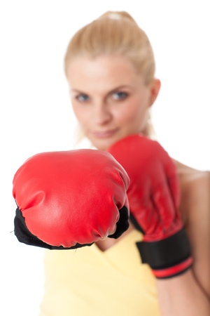Sporty young woman in red fighting gloves on a white background. Selective focus on gloves. Stock Photo - 17411948