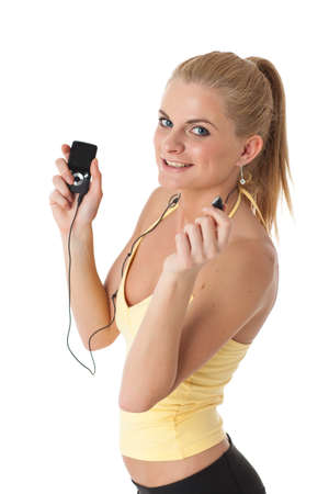 Sporty young woman with mp3 player on a white background. Stock Photo - 17411939