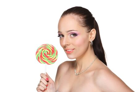 Happy young woman with lollipop on a white background. Stock Photo - 17636555