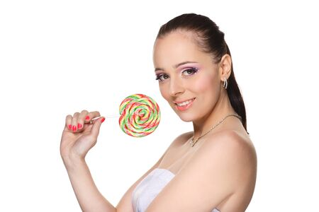 Happy young woman with lollipop on a white background. Stock Photo - 17632475