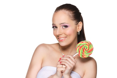 Happy young woman with lollipop on a white background. Stock Photo - 17632472