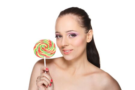Happy young woman with lollipop on a white background. Stock Photo - 17636494