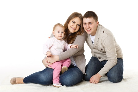 Young parents with their sweet  baby on a white background. Happy family. Stock Photo - 17788817