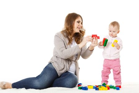 Mother with small baby play on a white background. Stock Photo - 17788835