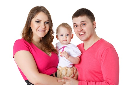 Young parents with their sweet  baby on a white background. Happy family. Stock Photo - 17788756