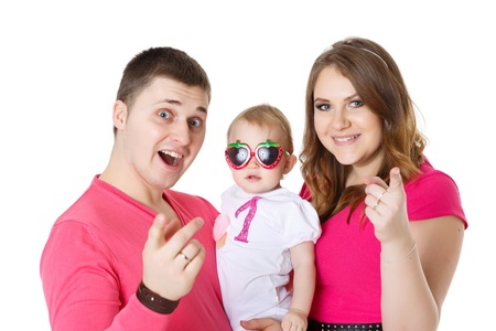 Young parents with their sweet  baby on a white background. Happy family. Stock Photo - 17788824