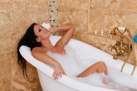 Young beautiful woman in a bathroom  Concept body care  photo