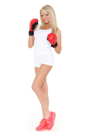 Sporty young woman in red fighting gloves on a white background. photo