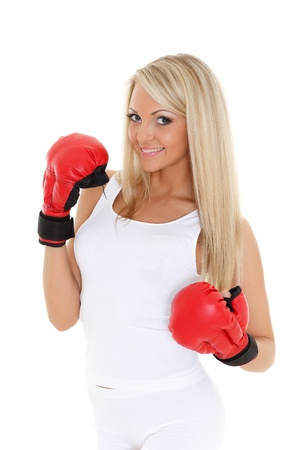 kick boxer: Sporty young woman in red fighting gloves on a white background.