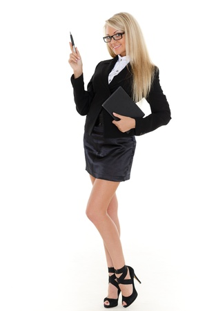 Business woman with daily log and pen stands on a white background. photo