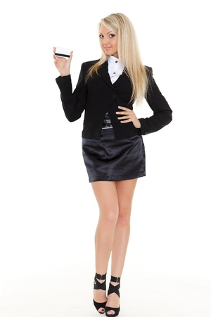skirt suit: Business woman with blank business card on a white background.