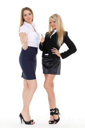 Two young business women showing sign ok on a white background. photo