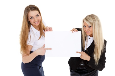 Two young business women with empty board for the text on a white background. photo