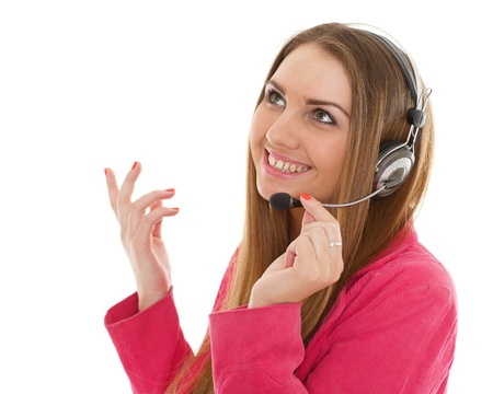 Happy young business woman with headset on a white background. Operator of support service. photo