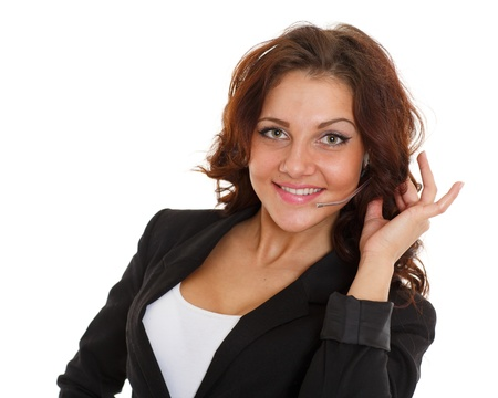 Happy young business woman with headset on a white background. Operator of support service. Stock Photo - 19671294