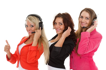Happy young business women with headset on a white background. Operators of support service. photo