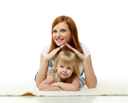 guardianship: Happy mother with sweet little daughter lay on a white background. Concept of care and protection. Stock Photo