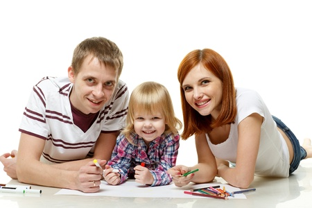Happy family drawing picture on a white background. photo