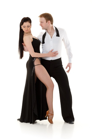 Dancing young couple on a white background. photo