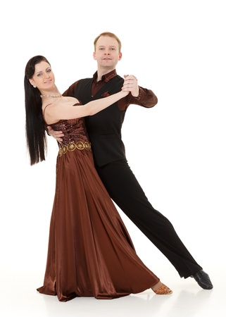 waltz: Dancing young couple on a white background. Stock Photo