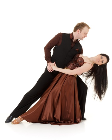 rhythmical: Dancing young couple on a white background. Stock Photo
