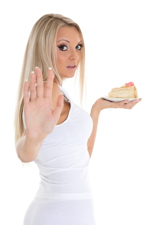 Young happy woman with delicious cake stands on a white background. photo