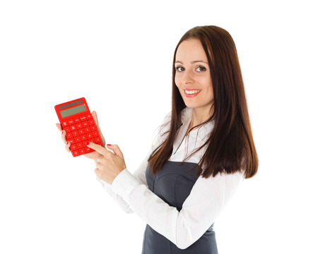 Young business woman with calculator stands on a white background. photo