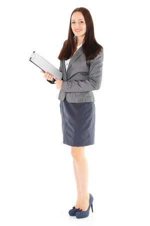 Businesswoman with clipboard stands on a white background. Stock Photo