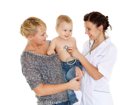 pediatrist: The female doctor with a stethoscope and  young mother with little son stand on a white background. Healthcare. Stock Photo