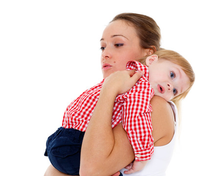resentful: Mother with small resentful baby on a white background.