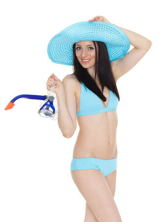 Young beautiful woman in bikini holds mask for diving standing on a white background. Vacation. photo