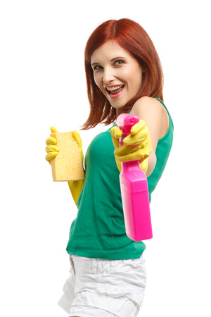 Young woman with spray bottle and sponge on a  white background.  Housekeeping. Cleaning woman. photo