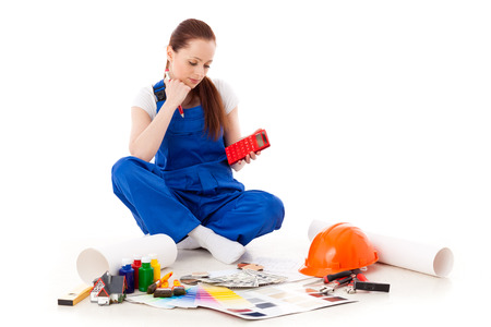 cost estimate: Female construction worker on a white background. Stock Photo
