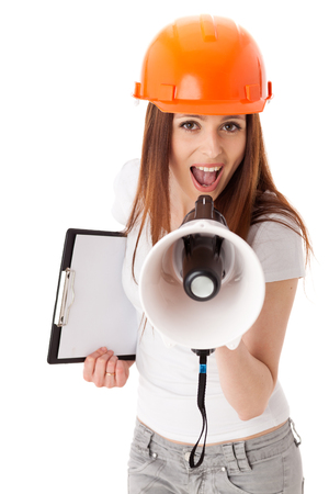 superintendent: Young female construction superintendent with megaphone and clipboard on a white background.