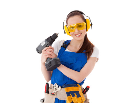 coverall: Young woman in  coverall with screwdriver on a white background. Female construction worker.