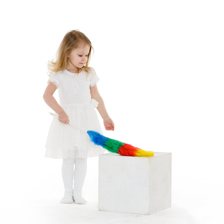 3 year old: Pretty little girl with whisk on a white background. Mothers assistant. 3 year old.