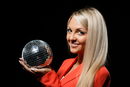 mirrored: Portrait of young beautiful woman with mirrored ball on a black background.