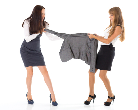 women fighting: Two young women fighting for jacket on a white background. Sale.