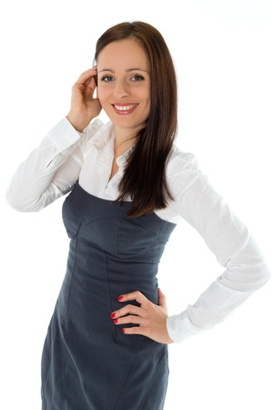 benevolent: Happy young businesswoman stands on a white background.