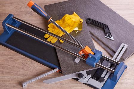 tile cutter: Manual cutter  and ceramic tiles for floor. Home repair.