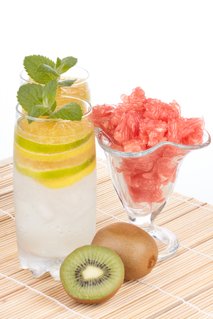 fruity: Summer fruity drink with ice on a white background. Stock Photo