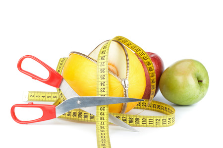 unzipped: Unzipped melon, apples and measuring tape. Healthy eating concept. Close up.