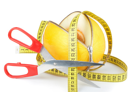 unzipped: Unzipped melon, scissors and measuring tape. Healthy eating concept. Close up.