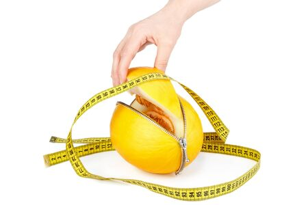unzipped: Unzipped melon and measuring tape. Healthy eating concept. Close up.