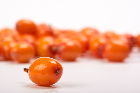 bacca: Sea-buckthorn berries on a white background. Selective focus.