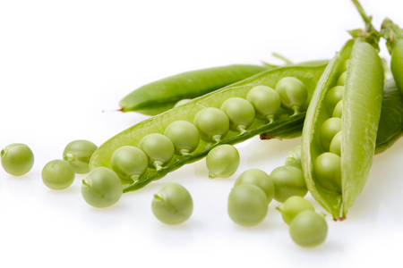 Fresh green peas  on a white background.