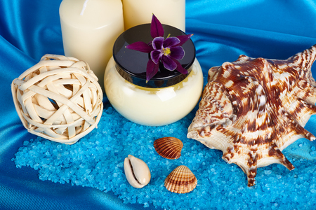 bath essence: Spa composition with sea-shell on the blue satin. Stock Photo